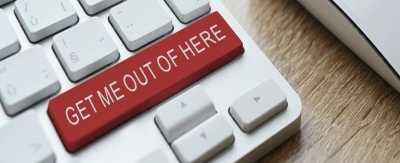 "A keyboard with a horizontal red key that reads ""Get Me Out of Here."""
