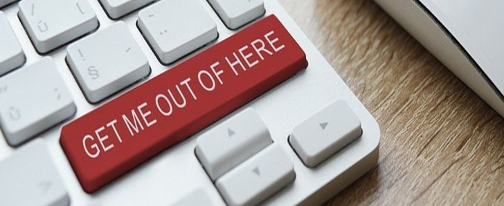 """A keyboard with a horizontal red key that reads """"Get Me Out of Here."""""""