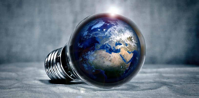 The Earth within the bulb of a lightbulb lying on its side