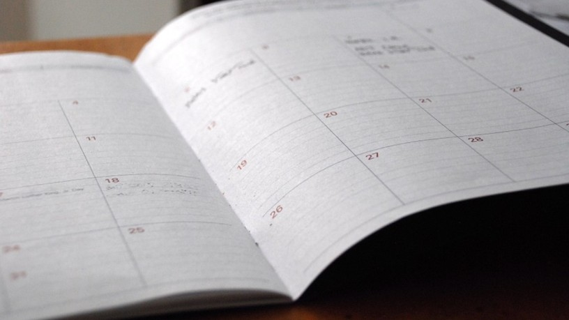 An open day planner on a desk