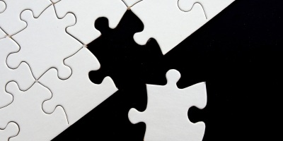 puzzle piece separated from puzzle